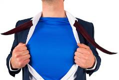 Man in business suit stripping down to superhero costume