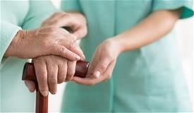 Nurse hold elderly hands