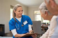 Nurse talking to elderly couple